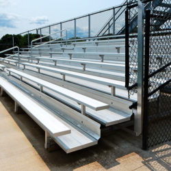 8 row bleachers with 4' aisle and black vinyl fenceguard at oconomowoc high school.