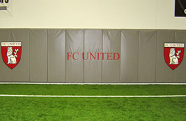 Wall Padding with Custom Logo at Indoor Soccer Complex.