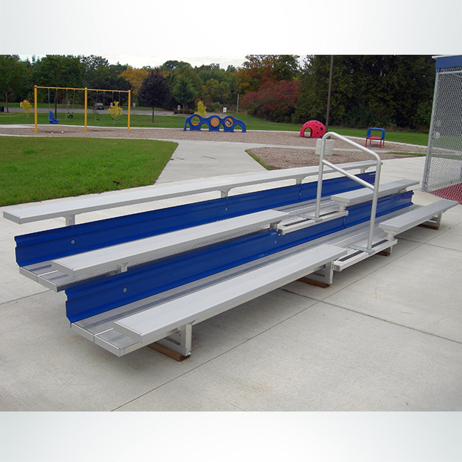 Model #B3R19A1. 3 row bleacher with blue risers and aisle with handrail.