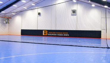 Sheer black custom tension divider net for indoor futsal fields.