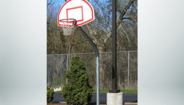 Model #KG460SSUR. Galvanized Gooseneck Basketball Hoop with 60 Degree Bend in Pole. Ideal for School Playground Use.