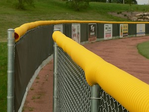Model #FCECON. Yellow Economy Fence Cap on Baseball Outfield Fence.