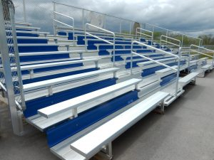 10 row custom bleachers with blue risers.