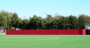 Custom red padding on fence.