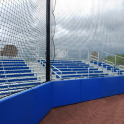 Royal Blue Custom Padding for Baseball Wall with Back-Up Netting in Front of Bleachers.