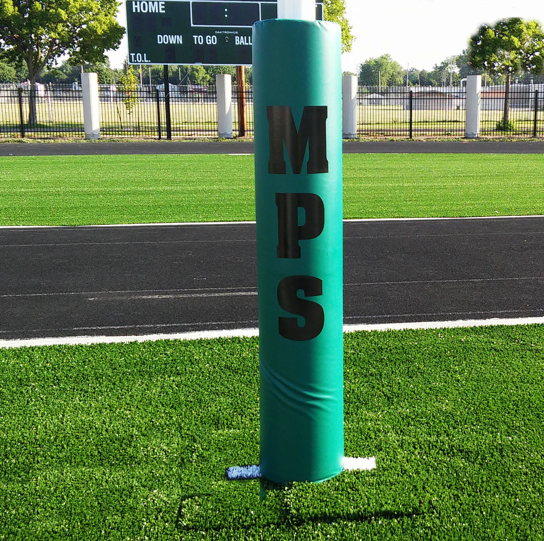 Custom padding for football post. Green with logo in black.