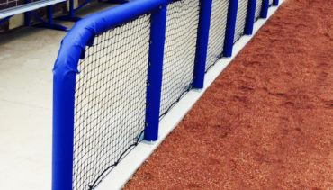 Blue padding for baseball dugout rails.