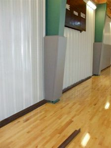 Padding for Tapered Columns in a Gymnasium.