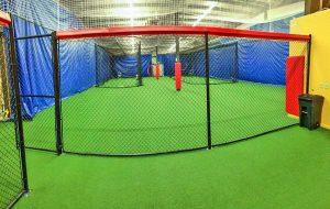 Custom padding for batting cage at indoor baseball facility.