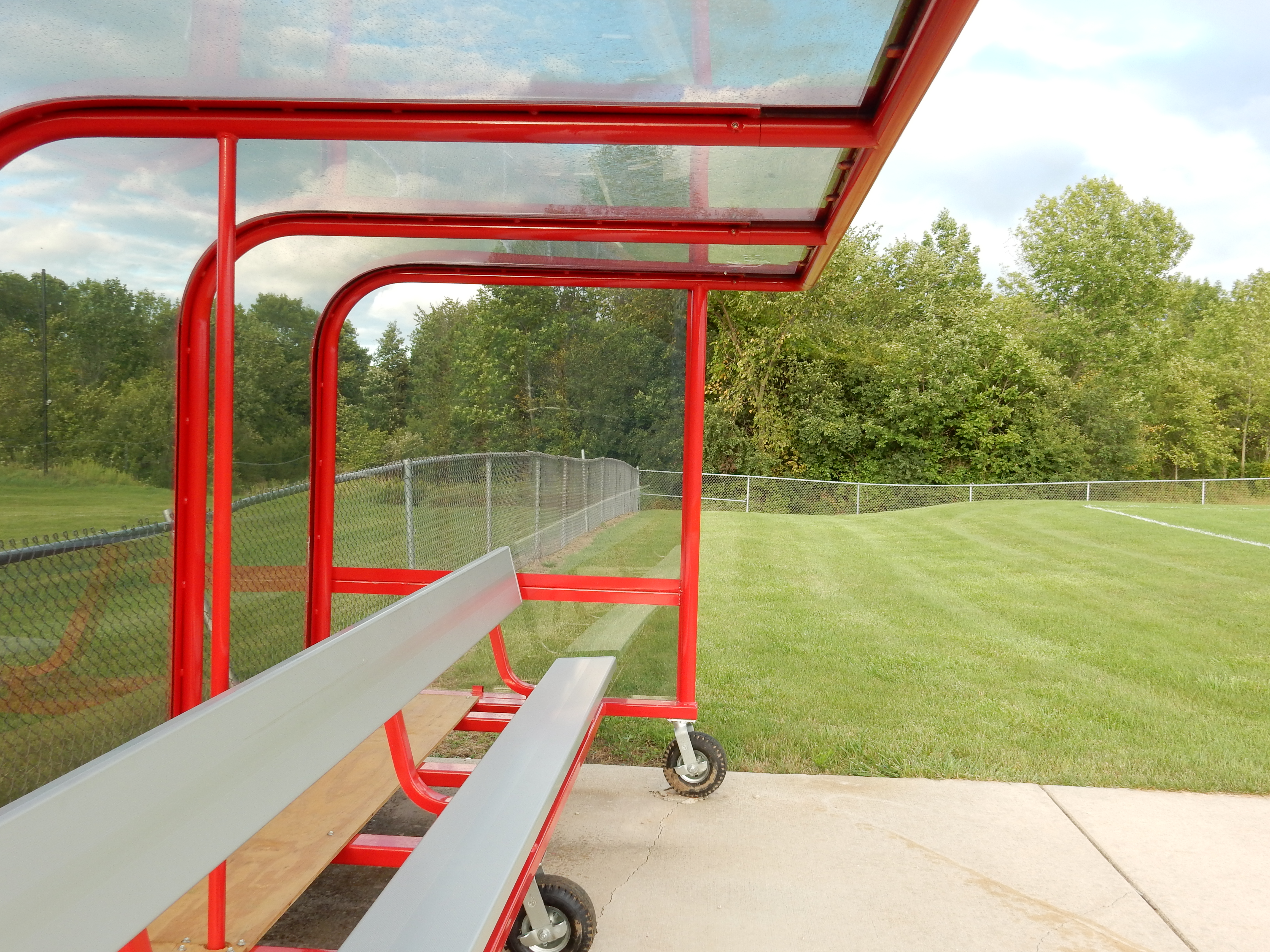 Model #PPS16PABSL. Box style soccer team shelter. Aluminum bench, red frame with wheels.