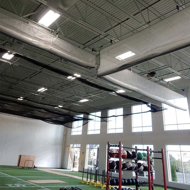 Batting cages and divider curtain in raised position.