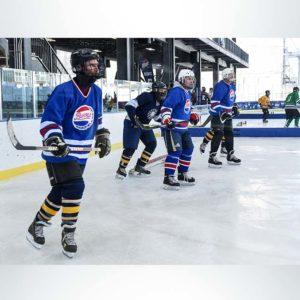 Model #FSP12. Royal blue portable padding boundary for outdoor ice hockey rink.