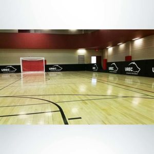 Model #FSP44. Protective Boundary Padding with Custom Logos for Indoor Soccer Field on Basketball Court.