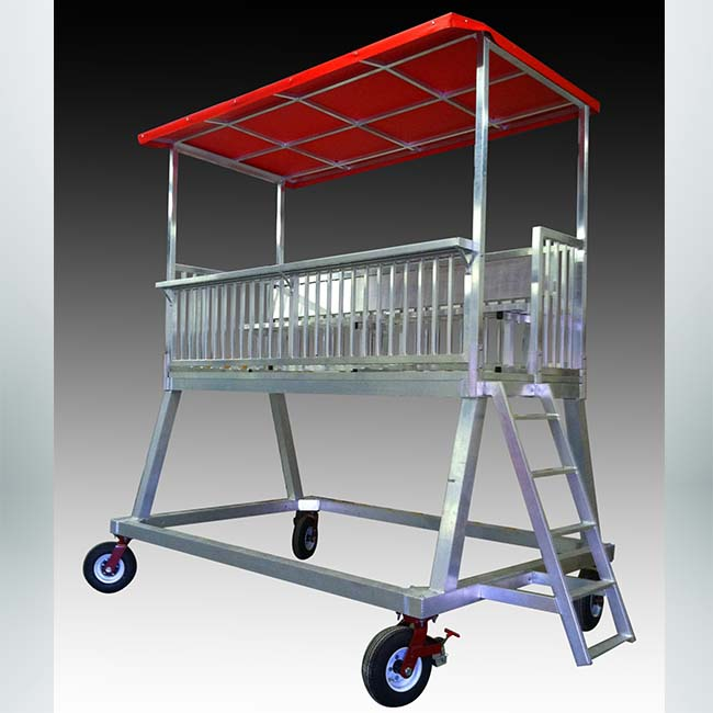 Model #TH10. Portable press box or filming tower with red top.