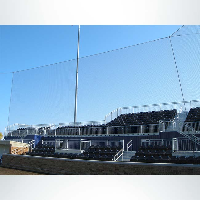 Tie-back netting in baseball stadium. Provides protection with minimal blocking of sight lines.