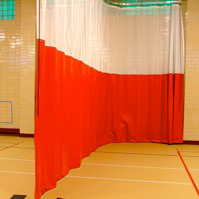 Walk-draw gym divider curtain in white mesh with orange vinyl.