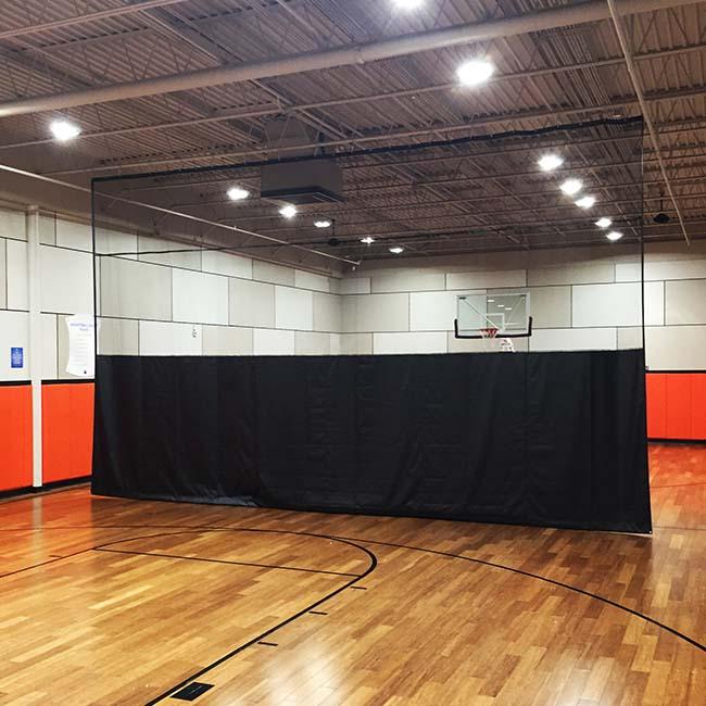 Flex mesh gym divider curtain. 18' x 30'.