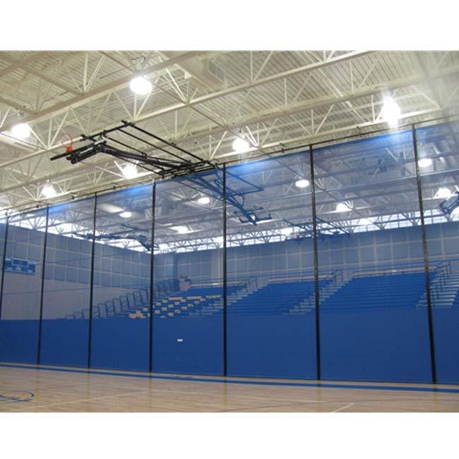 Motorized gym divider curtain. Flex mesh with vinyl in blue.