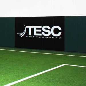 Wall pads with custom logo for indoor soccer facility. Forest green and black.