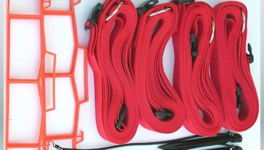 "Model #KSB. 2"" adjustable sand volleyball court boundary kit in red."