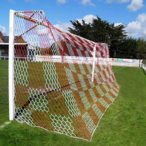 Red and white checkered soccer goal net on permanent soccer goal with European backstays.