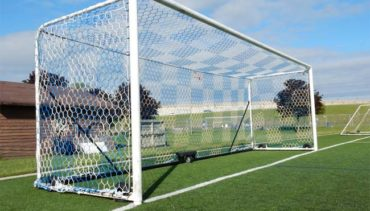 Model #M88WRD4824. Movable box style regulation size soccer goal. All caster wheels. Blue and white checkered net.