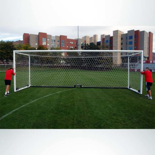 Model #M88WRD4824BOX66. Stadium box style wheeled soccer goal being moved by two people.