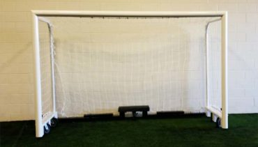 "M88WRD4CASTER. Heavy duty wheeled futsal goal with caster wheels and 4"" round posts."