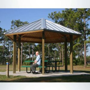 Model #RCPLWHEX20-06. 20' diameter laminated wood hexagonal park shelter with optional metal roofing.