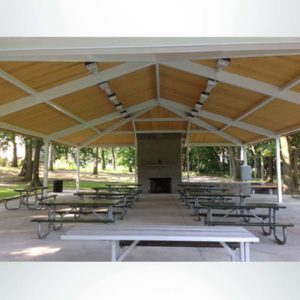 Gable style park shelter to cover picnic tables.