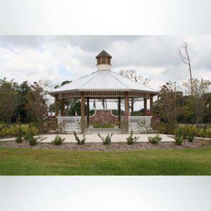 Model #RCPLWOCT25-06MC 25' radius laminated wood octagonal shelter with metal roof and optional cupola.