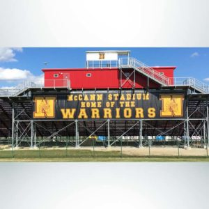 Windscreen for athletic stadium. Custom digital print black mesh. 88'W x 14'H.