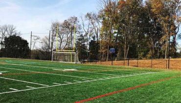 Custom Hybrid Soccer-Lacrosse-Football Goal with Backstop Netting for Athletic Field.