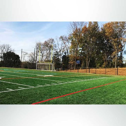 Custom hybrid soccer-lacrosse football goal with backstop netting for athletic field.