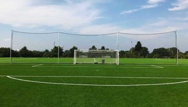 Model #KGBACKAL43P42090. 20' x 90' premium backstop nets for soccer field.