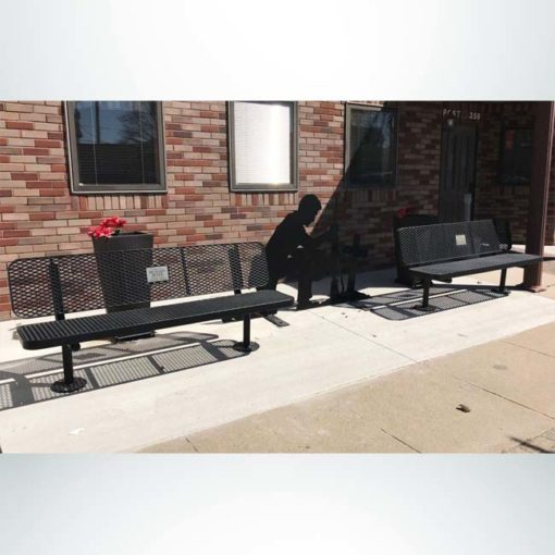 Model #PPS9363M7O99. Champion memorial bench. 6 foot, black, expanded metal, surface mount.