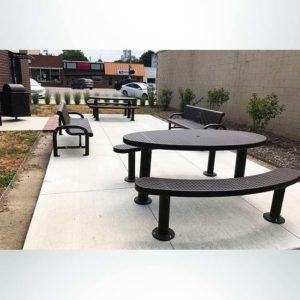 Model #PPS9563P5971303AB. Champion Oval Picnic Table. 3'x6', Brown, Perforated, Multi-Pedestal, Surface Mount.