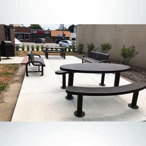 Model #PPS9563P5971303AB. Champion oval picnic table. 3' x 6', brown, perforated steel, multi pedestal, surface mount.