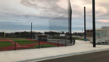 Tie-Back Backstop Net System for Baseball Field Allowing for Better Site Lines for the Fans.