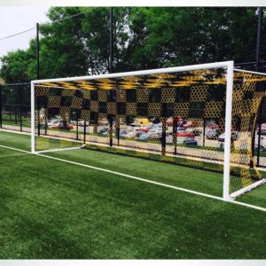 "Model #NP4HEX3082466HPBOX. Box style 3mm braided hexagonal 4"" mesh black and gold checkered soccer net."