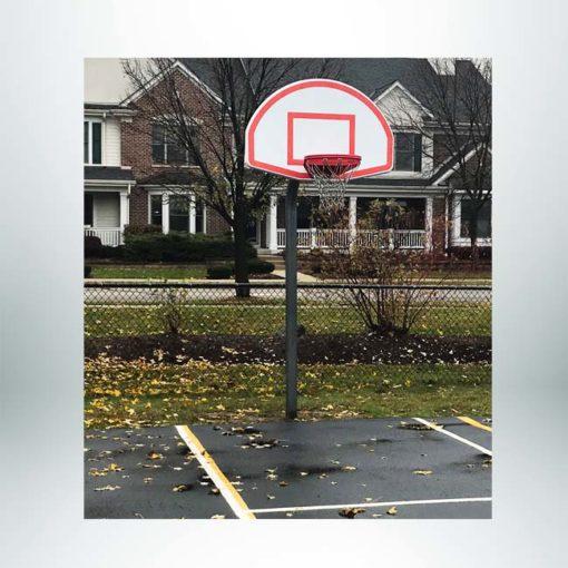 Model #KG4908. 8' Gooseneck basketball pole on grade school playground.