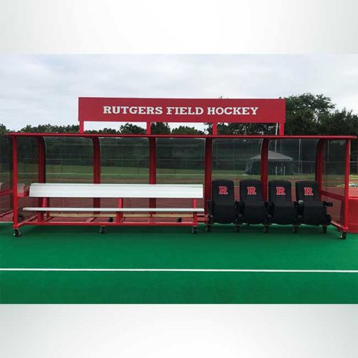 Red deluxe team shelter for field hockey. Aluminum benches with shelves. Custom leather seats. Custom logos.