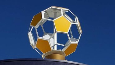 Gold soccer ball on the roof of the Copa Soccer Training Center
