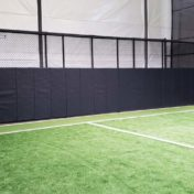 Custom Pads on Cage at Indoor Soccer Facility.