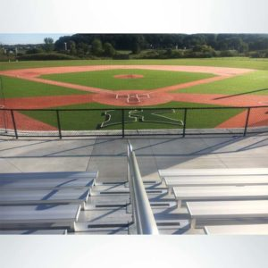 Custom engineered tieback baseball netting at a high school baseball stadium. View from bleachers.