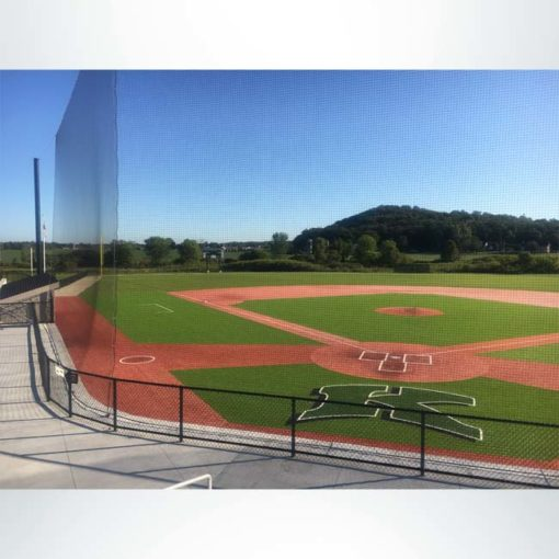 Custom engineered tieback baseball netting at a high school baseball stadium.