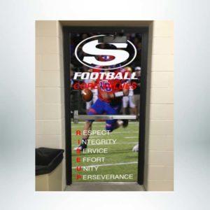 Single door shown after school branding door wrap with photo and core values.