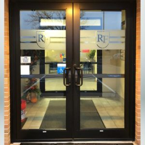 School branding frosted crystal (etched) vinyl on front entrance doors.