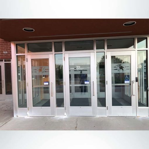 Windows at entrance of building shown after crystal (etched) vinyl is installed.