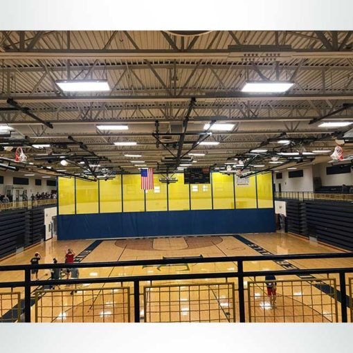 School gymnasium before hanging vinyl gym championship banners from ceiling.